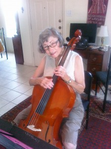 Barbara Rinard receives a cello lesson in 2010 as part of the Marian Anderson String Quartet Community Music School.